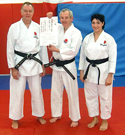 Adrian Thomas receives his 1st dan JKA Diploma
